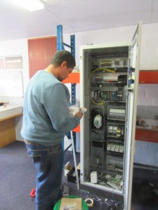Barpro Technician, Gary Smith, wiring a Storax mobile racking control panel